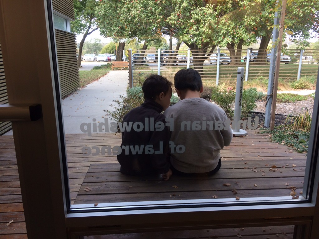 boys sitting outside the door
